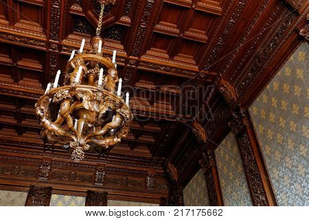 ST. PETERSBURG, RUSSIA - AUGUST 30, 2017: Oak chandelier after restoration in Yusupov palace. The palace is acclaimed as the Encyclopedia of St. Petersburg aristocratic interior