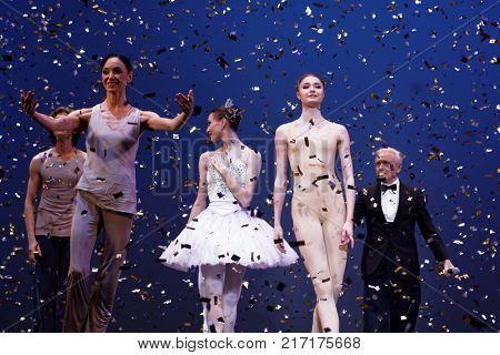 ST. PETERSBURG, RUSSIA - NOVEMBER 16, 2017: Ballet dancers on the stage after anniversary gala concert of Oleg Vinogradov (right). Great choreographer celebrated his 80th anniversary