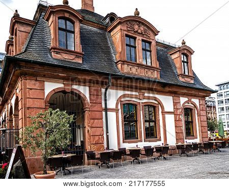 FRANKFURT, GERMANY-JULY 21, 2017: The historic Café Hauptwache is located in the middle of the city of Frankfurt. Popular meeting place since its opening over 100 years ago.