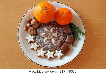 plate of Christmas goodies on a wooden table flat lay