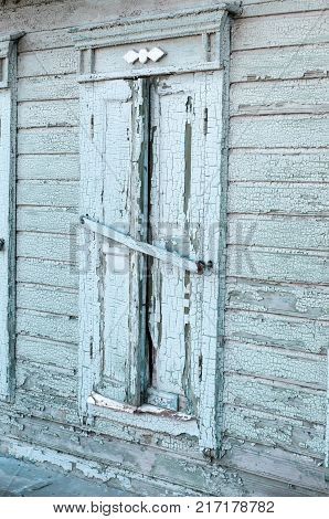 Old vintage retro wooden grey cracked paint window blinds, as historic architecture background