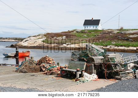 House and dock with lobster traps in Peggy's Cove Canada