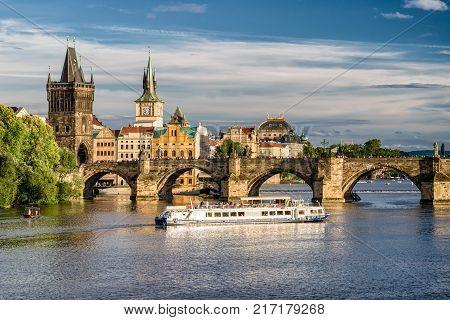 PRAGUE CZECH REPUBLIC - JULY 1: Charles bridge and cruiseship on river Vltava on July 1 2017 in Prague