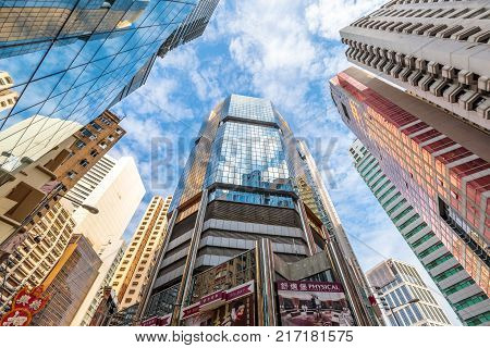 Hong Kong, China - December 6, 2016: low angle view of modern buildings facade reflect. Causeway Bay the famous luxury shopping district in Hong Kong Island.