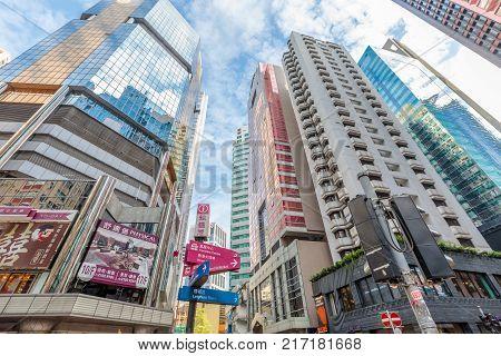 Hong Kong, China - December 6, 2016: modern buildings facade reflect in Causeway Bay the famous luxury shopping district, Hong Kong Island.