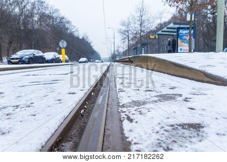 The Hague the Netherlands - February 11 2017: snow covered tram rails near a tram stop at Loosduinen The Hague