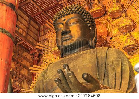 Nara, Japan - April 26, 2017: Details of Great Buddha or Daibutsu, the world's largest bronze statue of Buddha Vairocana. Todai-ji a Buddhist Temple in Nara, Japan.