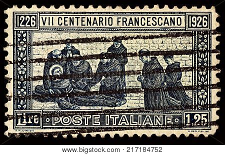 Moscow Russia - December 07 2017: A stamp printed in Italy shows death of St. Francis of Assisi series