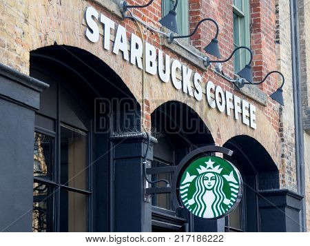 TORONTO CANADA - DECEMBER 21 2016: Starbucks logo on a Starbucks cafe in the city center of Toronto Ontario. The brand is one of the leaders in coffee service in Canada and worldwide