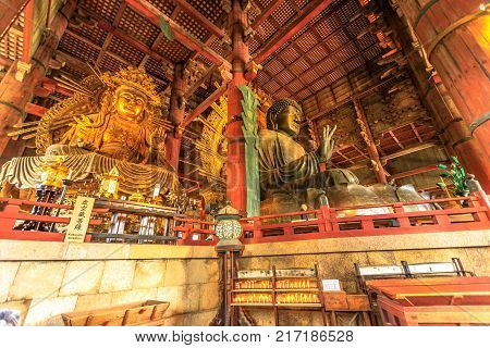 Nara, Japan - April 26, 2017: the Great Buddha or Daibutsu, the world's largest bronze statue of Buddha Vairocana, in the Great Buddha Hall of Todai-ji a Buddhist temple in Nara. UNESCO Heritage Site.