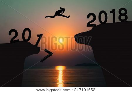 woman jump between 2017 and 2018 years.To success