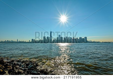New-York midtown view over Hudson River with blue sky and sun