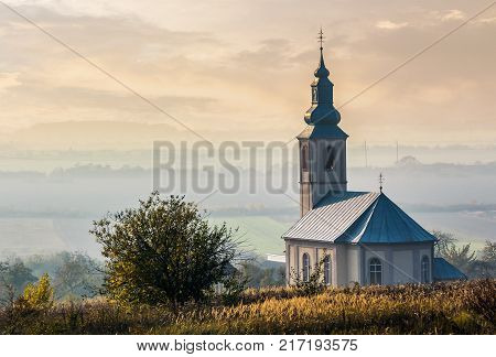 Church On A Hill At Sunset