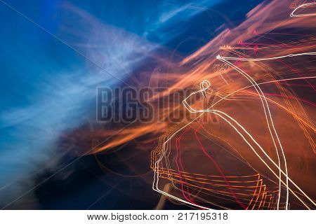 slow motion abstraction on the road. blurred background of car light traces and cloudy night sky. traffic wild energy concept