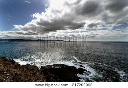 Partial view of the Ria de La Coruna on the Spanish Atlantic coast with a sky of clouds and sun