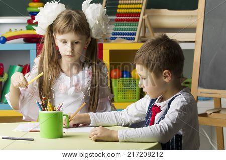 Preschool education. Children draw. Primary school children. Graduates of the kindergarten.