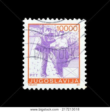 YUGOSLAVIA - CIRCA 1982 : Cancelled postage stamp printed by Yugoslavia, that shows Postman delivering post.