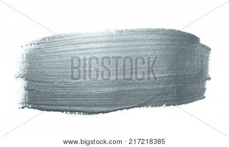 Silver glitter paint brush stroke or abstract dab smear with smudge texture on white background. Isolated glittering sparkling silver paint ink splash stain for luxury greeting card design template