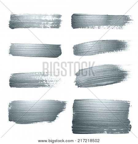 Silver glitter paint brush strokes set or abstract dab smears with smudge texture on white background for luxury greeting card design template. Isolated glittering silver paint ink splash stain