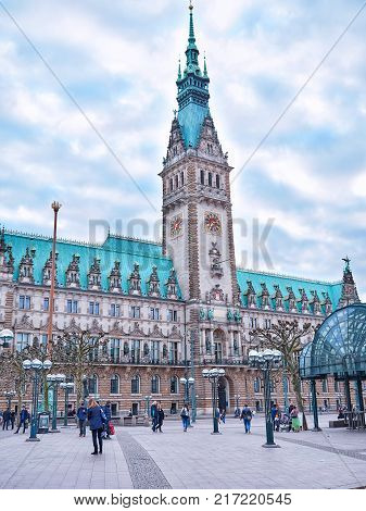 HAMBURG, GERMANY - APRIL 8, 2017: Famous Hamburg town hall with dramatic clouds, market square near lake Binnenalster in Altstadt quarter, Hamburg, Germany