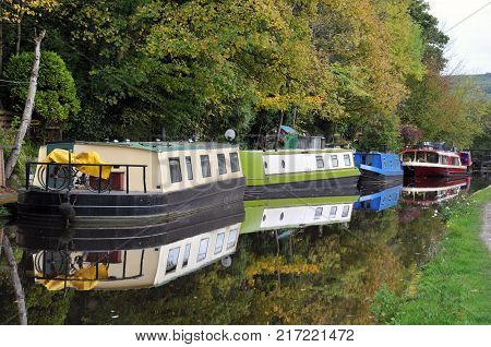 barges and houseboats moored along the rochdale canal near hebden bridge in west yorkshire
