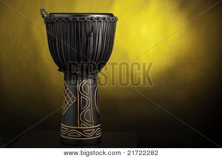 Black Djembe Drum Isolated On Yellow Spotlight