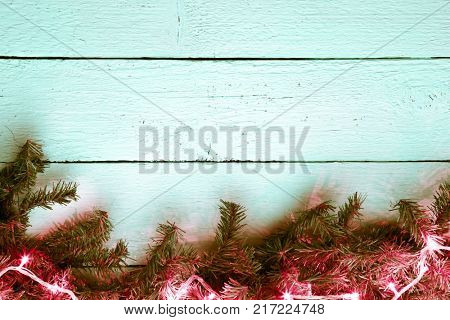 Wooden white texture background with christmas fir tree and ligh