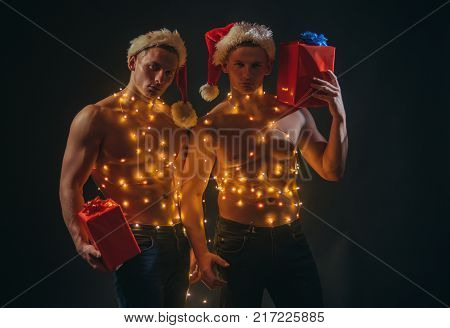 Twins Santa With Muscular Body In Garland.