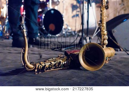 Tenor sax golden saxophone macro with selective focus on blue