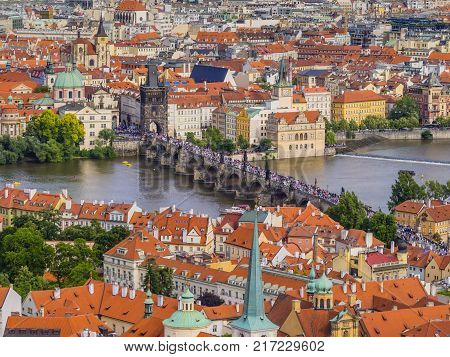 Panoramic view of old (Stare Mesto) and lesser (Mala Strana) town from St. Vitus Cathedral, with red roofs and Charles bridge through Vltava river, Prague, Czech Republic