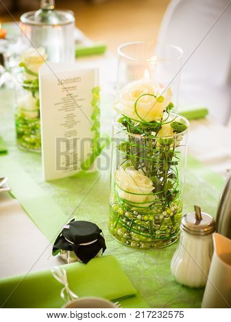 the green table decoration on the wedding table