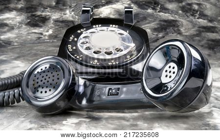 Old style black antique rotary telephone used in the 1960's..