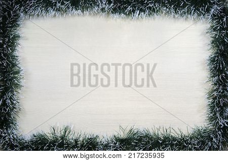 Christmas design-Christmas card fringed with pine needles with place for text. Studio photography.