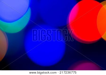 Blurred and defocused abstract multicolor background with christmas lights soft multicolored bokeh circles.