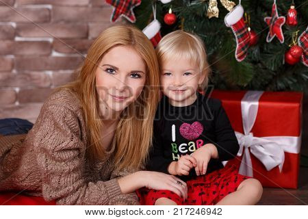 Sisters Best Friends Very Young Posing Together In Christmas Studio Close To New Year Pine Tree And