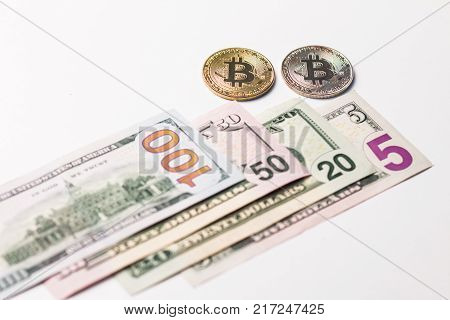 One hundred and seventy five dollars a usa and two coins of crypto currency on a white background.