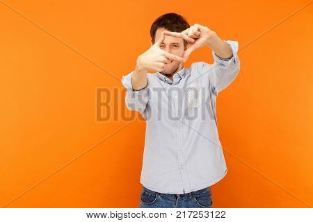 Creative And Composition Concept. Man Look's Like Photographer Looking At Camera.