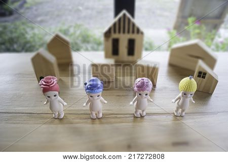 Group of baby naked doll on wooden table stock photo