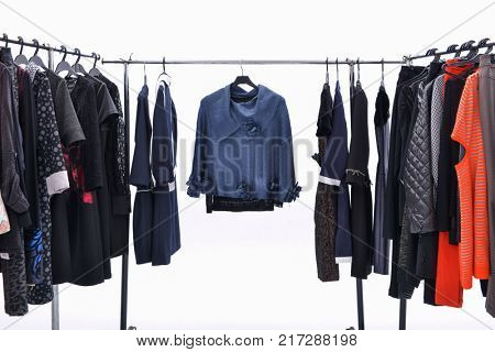 Set of different clothes for females on hanger