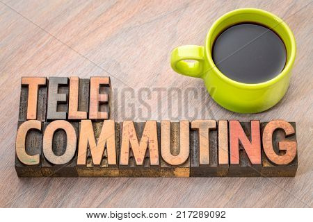 telecommuting - word in vintage letterpress wood type printing blocks with a cup of coffee