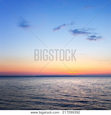 the dawn of a clear sky calm water / dawn on the reservoir landscape Ukraine