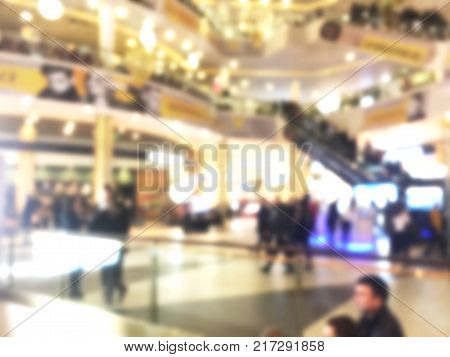 Abstract Blurred bokeh background with people in shopping mall with bokeh light. Blur image people in shopping mall. Shopping mall centre blur background with lights