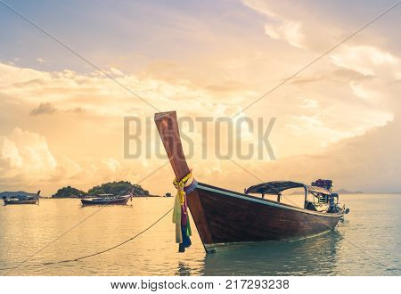 long tailed boat fishing boat motor boat on the sunset scene