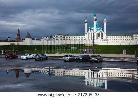 KAZAN, TATARSTAN, RUSSIA - MAY, 8 2016: Cars parked on the Tysyacheletiya Square (Millennium Square), one of the biggest squares in Russia, in front of Kazan Kremlin, UNESCO World Heritage Site