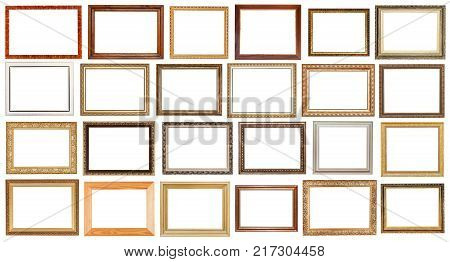 set of vintage wide wooden picture frames with cut out canvas isolated on white background