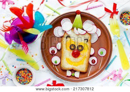 Birthday breakfast idea clown face sandwich top view