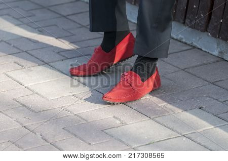 Man with red moccasins on a sunny day.