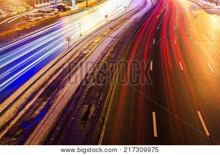 Speed Traffic Light Trails On Motorway Highway At Night, Long Exposure Abstract Urban Background.