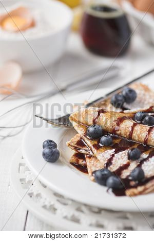 Freshly Prepared Crepes With Blueberries & Chocolate Sauce