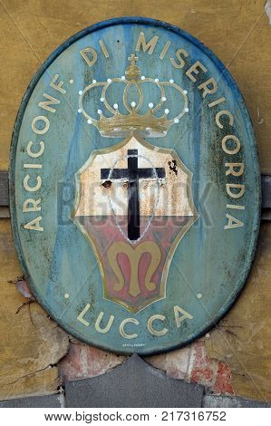 LUCCA, ITALY - JUNE 03: Coat of Arms of Arciconfraternita di Misericordia di Lucca, Tuscany, Italy on June 03, 2017.